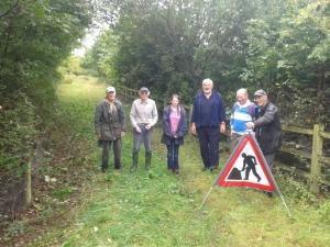 Volunteers by open Runfold Horse Margin track