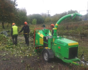 Volunteers use chipper