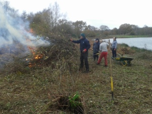 Loading the fire looking towards Colebrook Hide