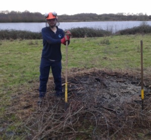 Callum clearing blackthorn left from fire