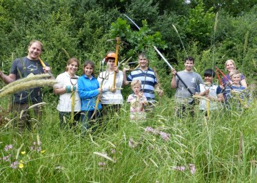RGS pose by wildflowers they're conserving - like ragged robin
