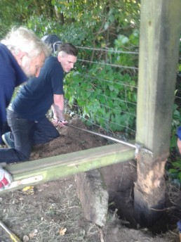 Vic and Jack using levers to lift the gate post