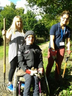 Charlotte leads path cutting HAP volunteers
