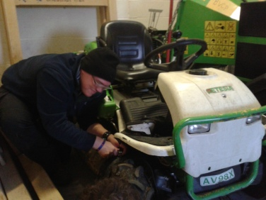 Student Adam Bates repairs ride-on-brushcutter