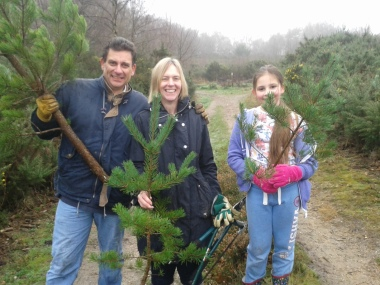 Family with freshly cut Christmas Trees