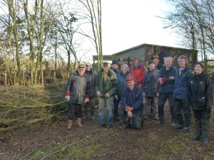 Proud volunteers by finished hedge