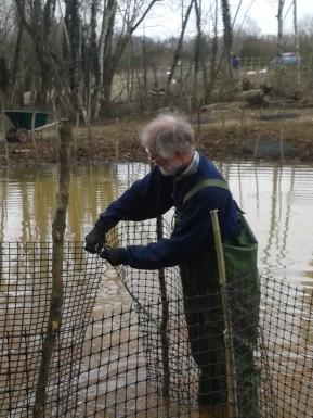 Bernard constructing the reed enclosures
