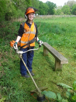 Trainee Katie strimming benches