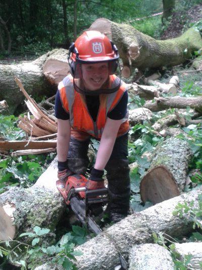 Jenny chainsawing a larger limb