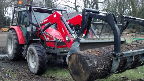 Shuffling logs with the front loader and claw