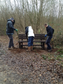 Gabriel, Jeremy and Matt checking the bench is level and tamping fown the soil