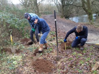 Gabriel and Jeremy digging the holes for the bench legs, whilst Matt measures his to check the depth